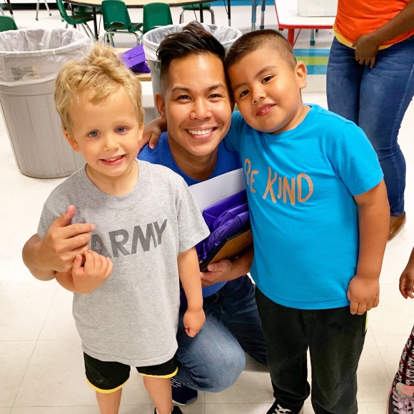 Josh with two kids at Learning Together, a non-profit where he sits on the Board of Directors