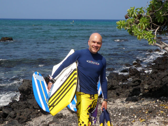 TK loves to surf, and when he can heads back to Hawaii to ride the waves.