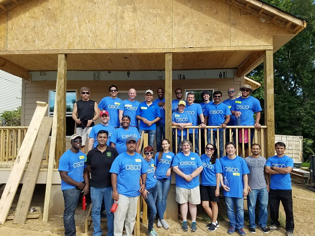 Employees in Durham participate in a Habitat for Humanity build