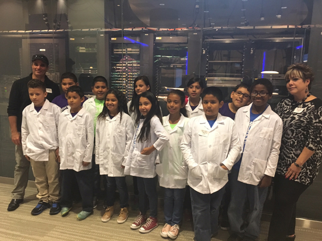 Students properly dressed in lab coats, visit the Cisco office in Richardson, Texas, to learn how a future in technology can shape their lives.