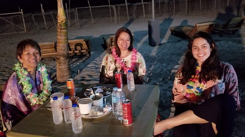 Laura with her mother and daughter Enjoying a celebratory luau at the end of the mission.