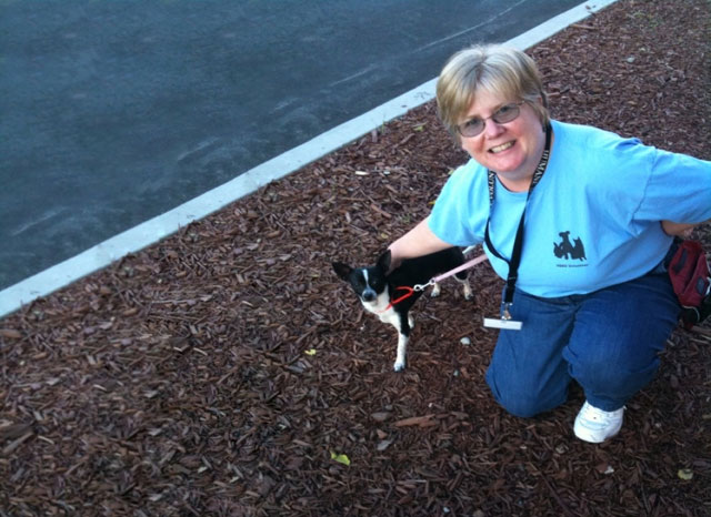 Kathy taking one of the shelter dogs for a walk